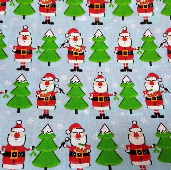 Christmas Polycotton SANTA ON BLUE