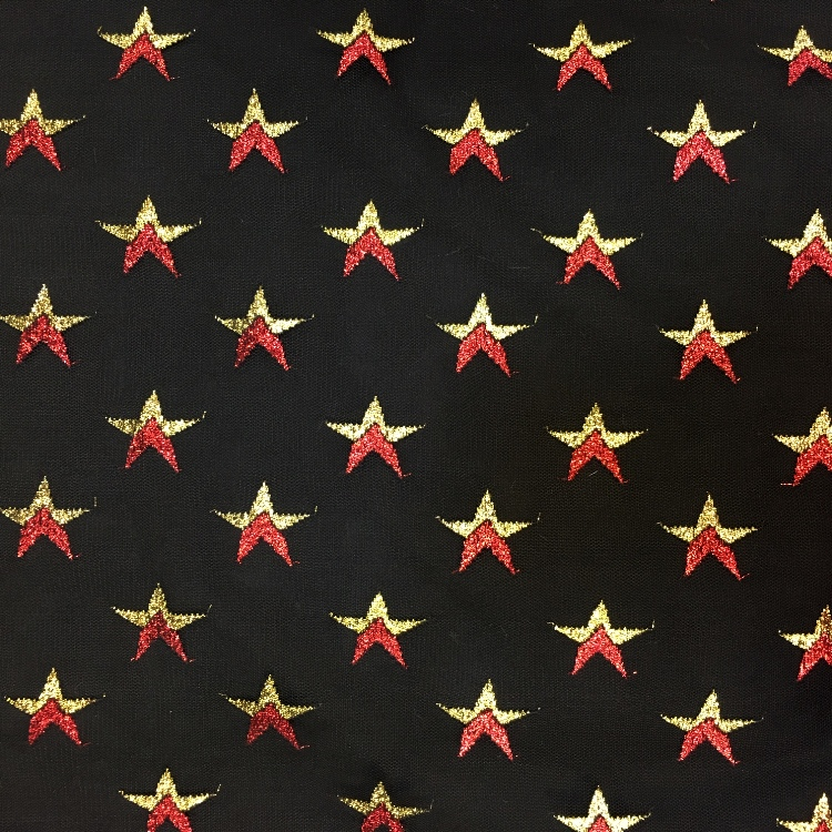 Halloween Fabric Red and Gold Stars on Black Net
