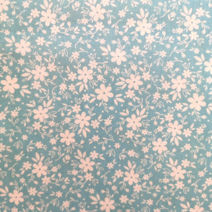 Small White Flowers on Sky Blue Polycotton